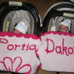 Twin Baby Girls LOVING their stroller blankees!